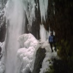 Iced over Tunnel Falls on the Eagle Creek trail in the Columbia River Gorge. I'm the blue blur on the right.