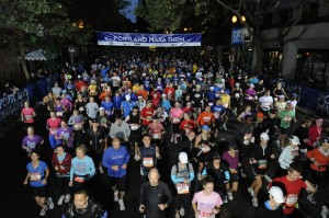 Another wave crosses the start line of the 40th Annual Portland Marathon