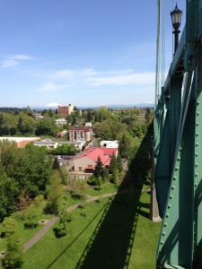 The St Johns Bridge casts a fantastic shadow over Cathedral Park, with Mt. Saint Helens and Mt. Adams in the distance.