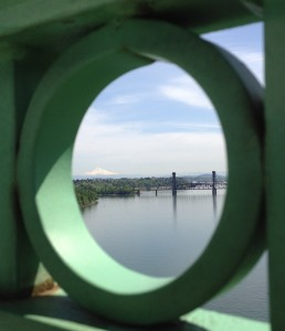 Mt. Hood and the Burlington Rail Bridge are perfectly framed from the St. Johns Bridge, Portland, Oregon