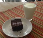 Post-workout recovery brownie and glass of milk