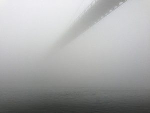 The St. Johns Bridge disappears over the Willamette River into the fog