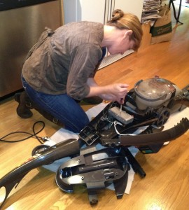 Shannon Wilkinson fixing the carpet cleaner.