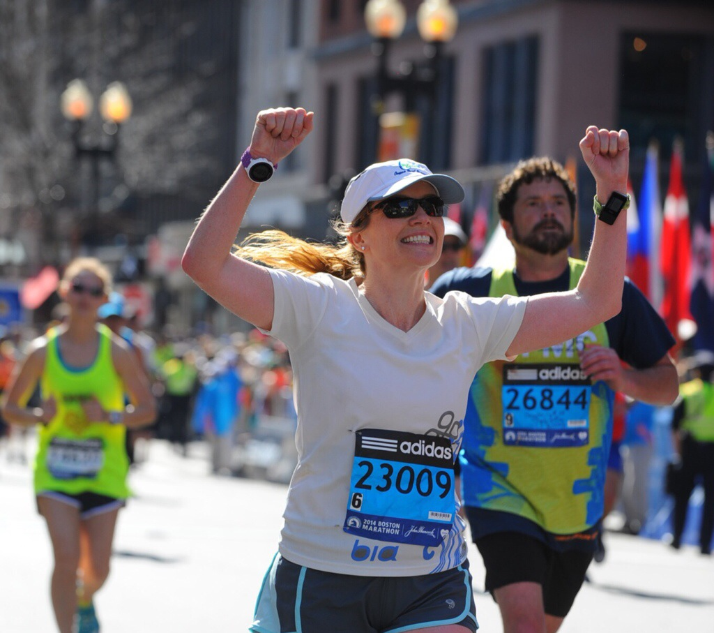 Shannon Wilkinson crosses the finish line of the 118th Boston Marathon - April 21, 2014